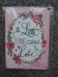 Schild 'a little thing called love'